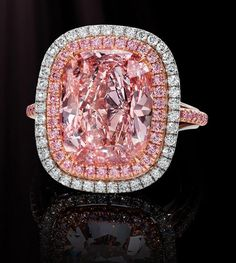 An exquisite example of increasingly rare Natural Pink Diamonds…a bright and brilliant pink, with just a hint of sweet, pastel orange. Surrounded by Argyle Pinks, the Cushion-Cut Diamond is a regal stone…a cherished collectible…and an extremely robust investment alternative. GIA Certified.