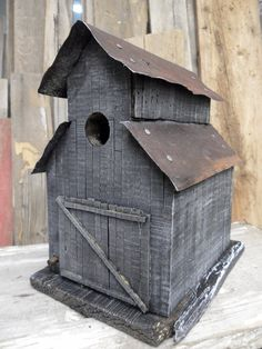 Barn birdhouse. Made like an old stable. Rustic look and antique tin roof.. $99.99, via Etsy.