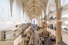 This 547-year-old Dominican church in the Netherlands was converted into a sleek modern bookstore while completely preserving the original structure in case the building is ever turned back into a church.   See more photos at the link:  http://www.thisiscolossal.com/2013/10/a-15th-century-cathedral-transformed-into-a-modern-bookstore/