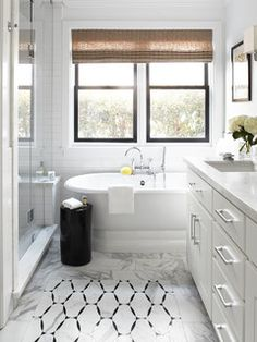 A freestanding tub with classic lines saves space (as opposed to a tub with a surround) while giving a nod to the age when the house was built.