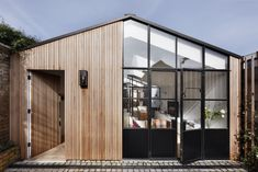 A Converted Garage gets a Light Transformation — Image Interiors & Living - Eco house Wood Cladding Exterior, House Cladding, Timber Cladding, Garage Roof, Garage Exterior, Car Garage, Transformation Images, Garage Transformation, Crittal Doors