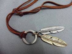 Brown real Leather and alloy feather pendant by sevenvsxiao, $9.00