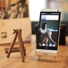 Easel Phone & Tablet Stand We genuinely believe that tattooing could be a method that's been used since the full … Wooden Phone Holder, Wood Phone Stand, Iphone Stand, Iphone 6, Support Telephone, Small Wood Projects, Tablet Stand, Business Card Holders, Easel