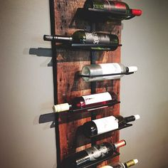 Salvaged barn wood combined with a welded steel wine rack create an urban + rustic look that is both functional and beautiful.  Each piece is made to order - no two are exactly alike. Wood may have original nail holes, marks, or various textures. * Holds 7 bottles * Overall dimensions of 40 long x 13 wide. This piece will be shipped fully assembled. It is designed to lean or hang on the wall. {Sorry, but wine is not included}   The pictures represent what we will make for you, however, you…