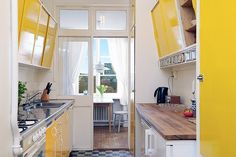 Yellow old kitchen with view. Kungsholmen, Stockholm, Sweden.