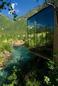 Designed by Norwegian architects Jensen & Skodvin, Juvet is a nature retreat that blends seamlessly with its wild environment. It's a striking landscape hotel, featuring seven small wood cabins perched on a river bank and nestled amongst birch, aspen, pine and nature-sculpted boulders.