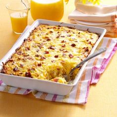 Amish Breakfast Casserole Recipe -We enjoyed a hearty breakfast bake during a visit to an Amish inn. When I asked for the recipe, one of the ladies told me the ingredients right off the top of her head. I modified it to create this version my family loves. Try breakfast sausage in place of bacon. —Beth Notaro, Kokomo, Indiana