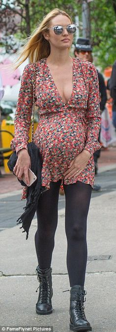 Maternity style: The expecting 27-year-old emulated nineties grunge in a red plunging babydoll floral frock and heavy combat boots