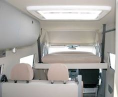"""DOMO Sprinter RVs use an electric bed which lowers from the ceiling of the van - lets you sleep 4 people in a 144"""" chassis Sprinter van,including kitchen and bathroom."""