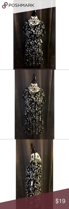 Old Navy Floral Dress Old Navy black and true white floral dress. Belt not included. Brand new with tags. Size XL but can fit up to 2xl. Old Navy Dresses Asymmetrical
