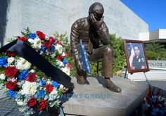 Flowers and a portrait of slain officer Galvez flank the fallen officer memorial at the police station in Downey, CA on Thursday, November 19, 2015. Downey police officer Ricardo Galvez was shot and killed in the police station parking lot in what detectives say was a botched robbery attempt. Three suspects have been detained. (Photo by Scott Varley, Daily Breeze)