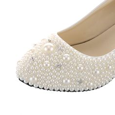Beige pearls wedding wedges shoes, the high heels about 1.2 inches and the soles is flat wedges.