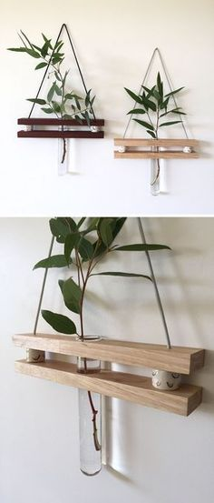 These modern hanging wall shelves made from reclaimed wood have a ledge to display a little trinket and a bud vase for a flower. #FunkyHomeDecor