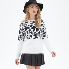 Forever 21 b and w animal print sweater S Forever 21 S round neck animal print sweater - very cute, so warm but not too bulky. Has a very adorable print and soft silky texture Forever 21 Sweaters Crew & Scoop Necks