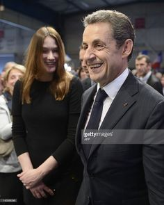 France's incumbent president and Union for a Popular Movement (UMP) party candidate for the French 2012 presidential election Nicolas Sarkozy and France's First Lady Carla Bruni Sarkozy leave after a campaign meeting on April 29, 2012 in the southwestern city of Toulouse. The latest opinion poll published on Sunday by the LH2 institute for web portal Yahoo! forecast that Hollande would comfortably win the May 6 run-off by 54 percent of the vote to Sarkozy's 46, with the gap narrowing. AFP…