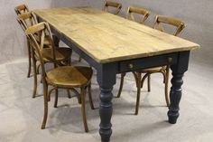 This is on my list to buy. The legs are painted in a dark grey and the table top is oak.