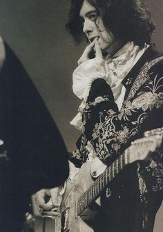 Jimmy Page! LOVE the jacket, wish this was in color!