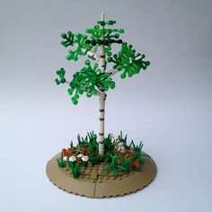 Finally found a use for those new white blaster shooters. With a combination of white round plates with a hole in the middle (to prevent accidental delimbing of the tree), they make for a decent birch/aspen tree. Legos, Lego Tree, Lego Boards, Cool Lego, Awesome Lego, Lego Modular, Lego Castle, Aspen Trees, Lego Design