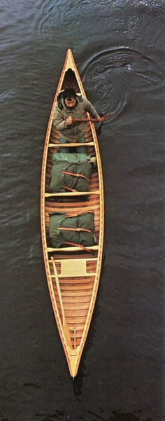 Beautiful wooden canoe and packs.