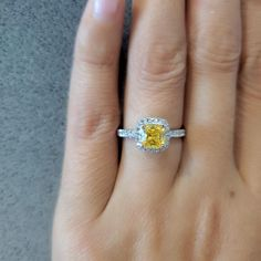 Excellent quality Man Made Cushion Cut Yellow Diamond, Halo setting engagement ring. It has a dazzling high polished platinum finish to make its shininess and durable.