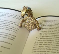 "Giraffe page holder... This might make me give up my Nook and iBooks and return to hardbacks... maybe.    From ""Jill"" at cutoutandkeep."