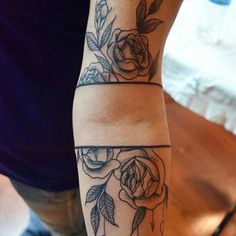 Flower and bars tattoo