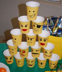 For cups either find Lego movie ones in store or buy yellow ones from dollar tree and draw Lego movie faces ;)