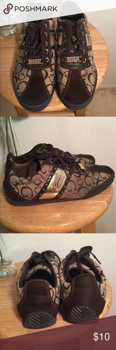 Guess Low Top Sneakers Very stylish low top Guess Sneakers. The gold accents give it a nice touch. Very comfortable. No box. Guess Shoes Sneakers