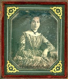 Young woman in a beautiful print dress, ca. 1850s.