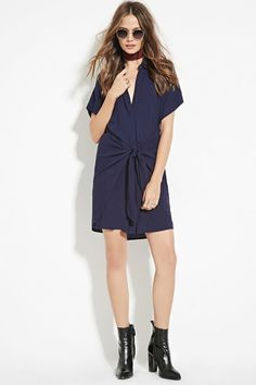 A navy shirt dress that ties in the front.