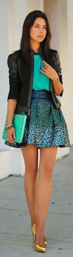 Luxurious look - blue silk blouse, hand bag and skirt in combination with black leather jacket and golden high heels.