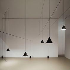 Designer Michael Anastassiades has created the String Light for FLOS