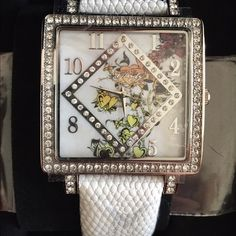 Ed hardy watch Beautiful brand new Ed hardy watch. Square face with crystal surround. True love face. White leather adjustable band. Just needs new battery. Ed Hardy Jewelry