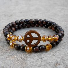 strength, ebony and peace sign mala bracelet stack