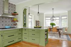 By swapping spaces, a couple gain a bright, welcoming kitchen all set for get-togethers. See all the little details of this stunning Tudor Revival kitchen remodel. New Kitchen, Tudor Kitchen, Remodel, Home Remodeling, Kitchen, Home, Tudor Style Homes, Old Houses, Kitchen Sitting Areas