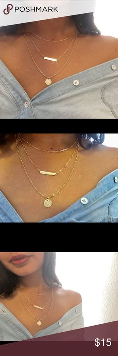 "NewShine Life Gold Layered Necklace  Layered Necklace is so simply stunning it will leave you speechless! Three layers of gold chain are embellished with charms, drop chains, and a circle pendant. Shortest layer measures 12"" with a 2"" extender chain. Lobster clasp closure. Man made materials. Jewelry Necklaces"