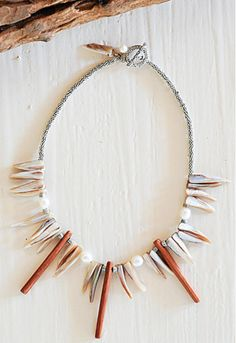 Mukwa wood, shell & freshwater pearl necklace. Hand-made with fair trade principles in Zambia, selling in London and at https://www.facebook.com/kuducollection