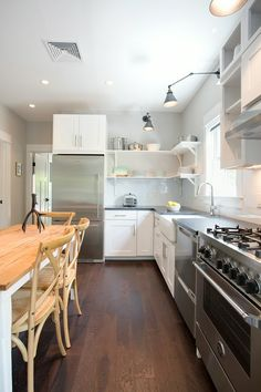 Love this kitchen, from the open shelves to the gas stove. I can so see myself cooking here.