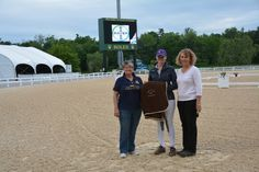 Kathryn Stoy winner of the 27th Annual Dressage Show Open Weighted High score Championships. Beth Haist with The Horse of Course presenting the winner a cooler. Congratulations!