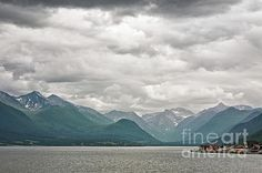 Andalsnes and mountains along the Romsdalsfjorden under a cloudy sky, Norway