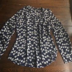 Navy chevron pattern blouse Long sleeve light weight navy blouse with a great option to roll the sleeves up and button them. Only worn a few times. It's in great condition !! 100% Polyester a.n.a Tops Blouses