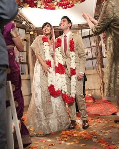 """For her wedding to Schmidt (Max Greenfield) in season five, Cece (Hannah Simone) purchased a hideous, over-the-top, light-up wedding dress during a drunken dress-shopping excursion with Winston (Lamorne Morris). Thankfully, best maid of honor everJess (Zooey Deschanel) managed to transform the mess into a gorgeous wedding dress. Costume designer Debra McGuire turned the gown inside out, topped with a gold lace overlay, and added a train.    """"I felt like the wedding dres..."""