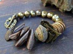 The Spoils of Thieving - OOAK artisan lampwork, wood, rustic pearl, sari silk and bronze bracelet. by PreciousViolet on Etsy