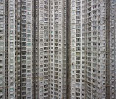 new residential complex buildings under construction, covered in bamboo scaffolding. Hong Kong 2010. Photo by Michael Wolf