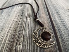 Handcrafted leather necklace with healing crystal cabochon. Wire Wrapped Jewelry, Wire Jewelry, Jewelry Crafts, Jewelry Necklaces, Moon Jewelry, Pagan Jewelry, Chakra Jewelry, Leather Necklace, Stone Necklace
