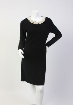 """Details:  Size M  Pearl details around the collar  Bust: 33"""" Waist: 30"""" Hip: 35"""" Length: (from shoulder down) 39"""" Sleeve length: 24.5""""    Material:  100% Wool   Condition:  Worn once, excellent condition."""