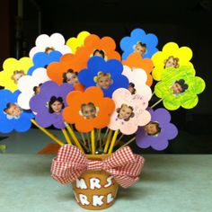 Teacher flower pot with pictures from each student