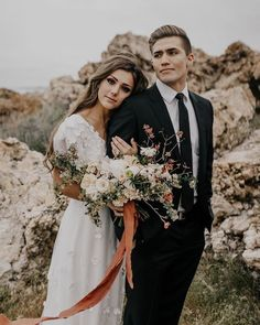 Bride and groom wedding portrait photography pose. Rust and neutral wedding bouquet. Black suit groom style.