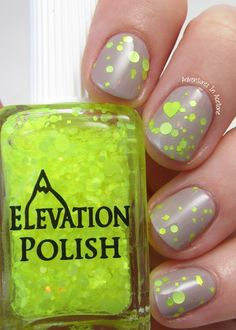 SBP: Yeti's Huanghan  Description: Clear based glitter topper. Arrangement of neon yellow glitters in hexes, squares, hearts, circles in two sizes and sparse red flake shimmer