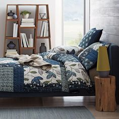 Lofthome By The Company Store® Suffolk Patchwork Quilt / Sham - This beautiful contemporary quilt offers a modern mélange of hand-drawn vines, stamped leaves and tile prints cast in cool shades of blue and ivory. Designed for season-spanning comfort, our Suffolk Patchwork Quilt is hand-quilted entirely of pure cotton.